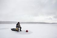 Duane Kniskern of Pine Bush ices fishes on Glenmere Lake in Florida during a snow squall on Tuesday, Jan. 22, 2013. He said the ice was about four inches thick.
