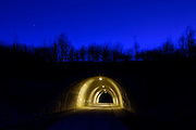 andy spain architectural photography tunnel at night blue sky trees colour
