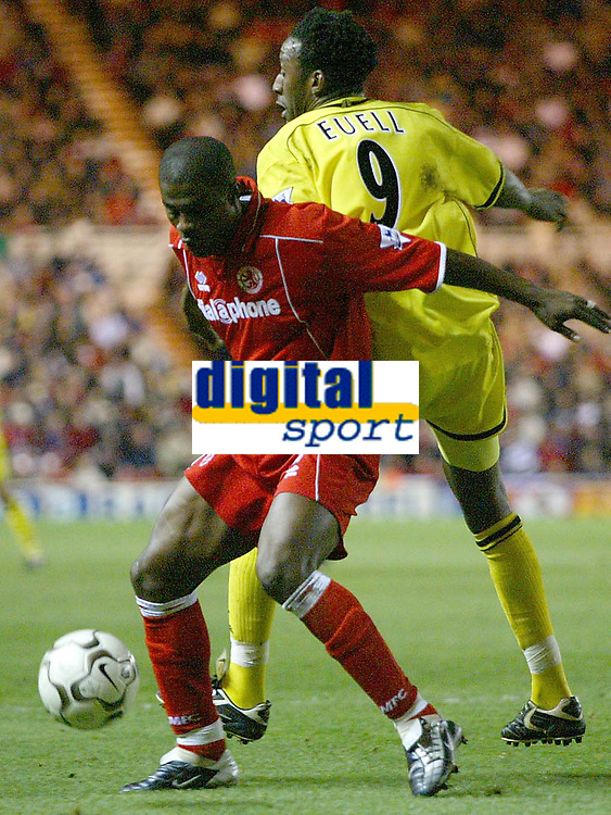Photo. Andrew Unwin.<br /> Middlesbrough v Charlton Athletic, Barclaycard Premier League, Riverside Stadium, Middlesbrough 13/12/2003.<br /> Middlesbrough's George Boateng (l) holds off Charlton's Jason Euell (r).