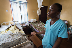 2 November 2019, Ganta, Liberia: Ganta Hospital nurse Loretta Nyawonse tends to a young female patient recovering from surgery. After being bitten by her brother, the patient suffered an abdominal rupture necessitating surgery. Located in Nimba county, the Ganta United Methodist Hospital serves tens of thousands of patients each year. It is a founding member of the Christian Health Association of Liberia.