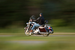 A man cruises down the freeway on his motorcycle