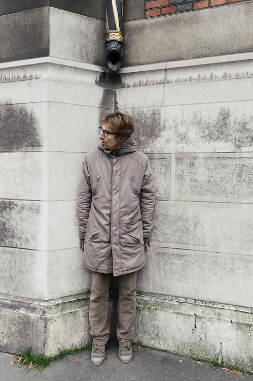 PARIS, FRANCE. NOVEMBER 22, 2010. French actor and writer Lorant Deutsch at the Parc Monceau, close to his home in the 17th arrondissement. He's lying against the wall of the gothic-styled Banque de France. (photo: Antoine Doyen)
