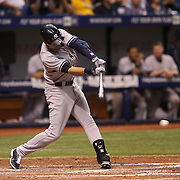 New York Yankees shortstop Derek Jeter (2) hits the ball during a major league baseball game between the New York Yankees and the Tampa Bay Rays at Tropicana Field on Thursday, Sept. 17, 2014 in St. Petersburg, Florida. The Yankees won the game 3-2 and this was Jeter's last game against Tampa Bay. (AP Photo/Alex Menendez)