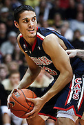 SHOT 1/21/12 5:56:45 PM - Arizona's Nick Johnson #13 looks to pass in front of Colorado's Nate Tomlinson #1 during their PAC 12 regular season men's basketball game at the Coors Events Center in Boulder, Co. Colorado won the game 64-63..(Photo by Marc Piscotty / © 2012)