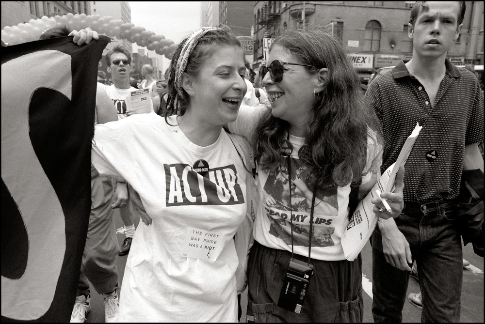 """Amy & Maxine Wolfe of ACT UP NY, on June 24, 1989, the 20th anniversary of the Stonewall riots, participating in a renegade march up 6th avenue to Central Park. Themed, """"In The Tradition"""", this march followed the same route as the original march 20 years ago and was designed as a rebuke to the corporatization of the gay pride parade."""