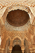 """Arabesque Moorish stalactite or morcabe ceilings,  Palacios Nazaries  of the Alhambra. Granada, Andalusia, Spain. . The Alhambra is a palace and fortress complex located in Granada, Andalusia, Spain. It was originally constructed as a small fortress in 889 CE on the remains of ancient Roman fortifications. The Alhambra was renovated and rebuilt in the mid-13th century by the Arab Nasrid emir Mohammed ben Al-Ahmar of the Emirate of Granada, who built its current Alhambra palace and walls. The Alhambra was converted into a royal palace in 1333 by Yusuf I, Sultan of Granada. The decoration of The Alhambra consists for the upper part of the walls, as a rule, of Arabic inscriptions—mostly poems by Ibn Zamrak and others praising the palace—that are manipulated into geometrical patterns with vegetal background set onto an arabesque setting (""""Ataurique""""). Much of this ornament is carved stucco (plaster) rather than stone. Tile mosaics (""""alicatado"""") of The Alhambra, with complicated mathematical patterns (""""tracería"""", most precisely """"lacería""""), are largely used as panelling for the lower part. .<br /> <br /> Visit our SPAIN HISTORIC PLACXES PHOTO COLLECTIONS for more photos to download or buy as wall art prints https://funkystock.photoshelter.com/gallery-collection/Pictures-Images-of-Spain-Spanish-Historical-Archaeology-Sites-Museum-Antiquities/C0000EUVhLC3Nbgw <br /> .<br /> Visit our ISLAMIC HISTORICAL PLACES PHOTO COLLECTIONS for more photos to download or buy as wall art prints https://funkystock.photoshelter.com/gallery-collection/Islam-Islamic-Historic-Places-Architecture-Pictures-Images-of/C0000n7SGOHt9XWI"""