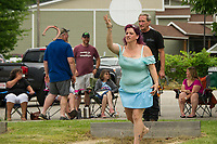 Angela Clifford takes her throw with Mike Brady during the Kip Guay Pete Sevigney annual horseshoe tournament at American Legion Post 1 on Saturday.  (Karen Bobotas/for the Laconia Daily Sun)
