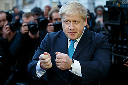 © Licensed to London News Pictures. 21/02/2016. London, UK. Mayor of London Boris Johnson giving a statement on his preference in the EU referendum outside his house in London on Sunday, 21 February 2016. Photo credit: Tolga Akmen/LNP