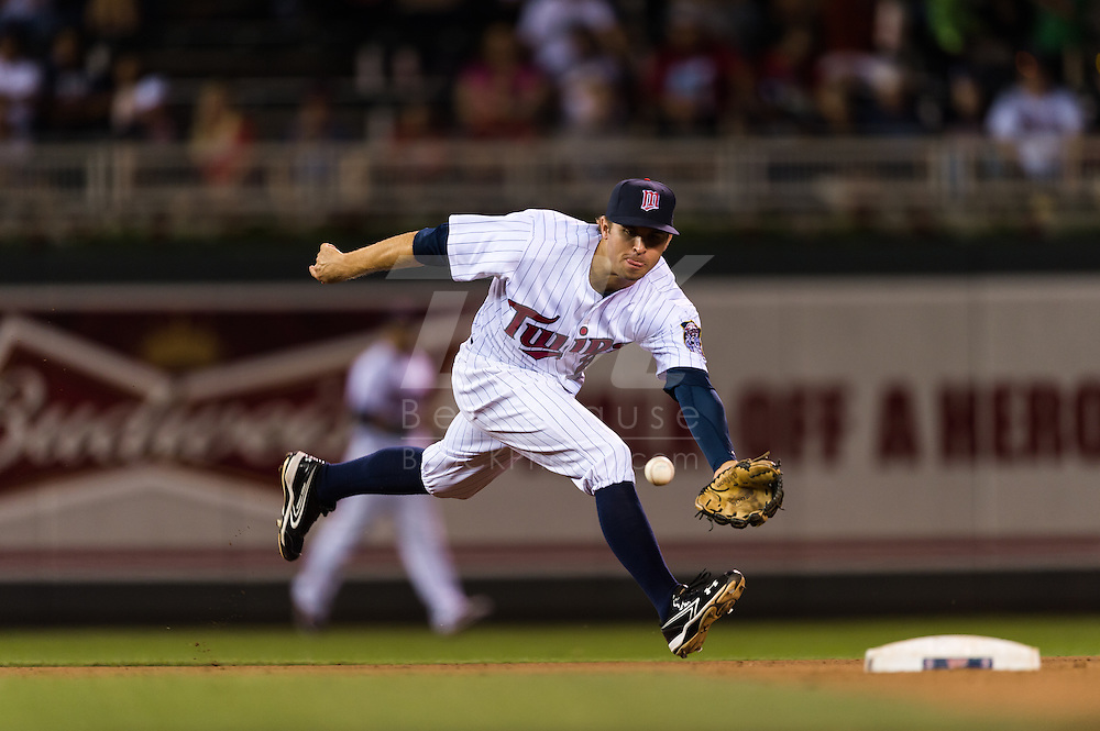 Brian Dozier (20) of the Minnesota Twins stops a ground ball during a game against the Tampa Bay Rays on August 10, 2012 at Target Field in Minneapolis, Minnesota.  The Rays defeated the Twins 12 to 6.  Photo: Ben Krause