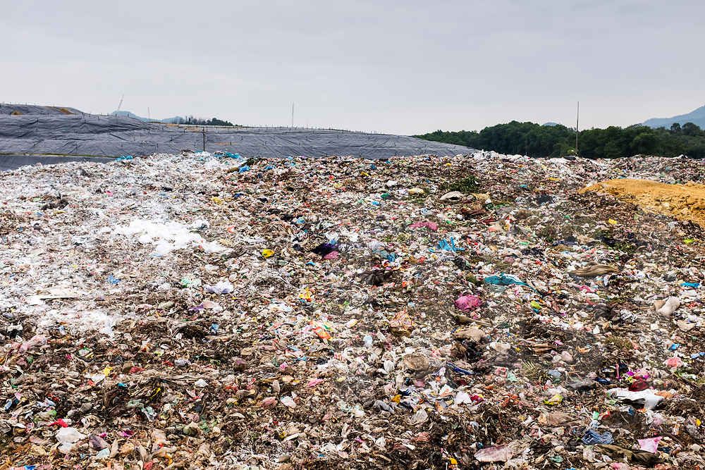 Landfill site in Nam Son commune near Hanoi that lands between 4000 tones to 5000 tones of rubbish per day on a 83.5 hectares field. Vietnam, Southeast Asia