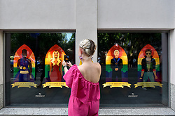 © Licensed to London News Pictures. 07/07/2017. London, UK. Images of (L to R) Boxer Nicola Adams, actress Laverne Cox, comedienne Ellen Degeneres and singer George Michael.  Sarah Hardcastle of Mr President, a Soho advertising agency, unveils a tribute to modern icons of tolerance and acceptance, to support the LGBT community, ahead of the annual Pride parade tomorrow.   Photo credit : Stephen Chung/LNP