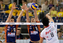 Matevz Kamnik and Andrej Flajs of ACH vs Neves Leandro Vissotto of Trentino at 2nd Semifinal match of CEV Indesit Champions League FINAL FOUR tournament between ACH Volley, Bled, SLO and Trentino BetClic Volley, ITA, on May 1, 2010, at Arena Atlas, Lodz, Poland. (Photo by Vid Ponikvar / Sportida)