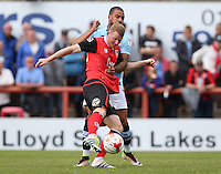 Morecambe's Alex Whitmore battles with Blackpool's Kyle Vassell<br /> <br /> Photographer Stephen White/CameraSport<br /> <br /> Football - The EFL Sky Bet League Two - Morecambe v Blackpool - Saturday 13th August 2016 - Globe arena - Morecambe<br /> <br /> World Copyright © 2016 CameraSport. All rights reserved. 43 Linden Ave. Countesthorpe. Leicester. England. LE8 5PG - Tel: +44 (0) 116 277 4147 - admin@camerasport.com - www.camerasport.com
