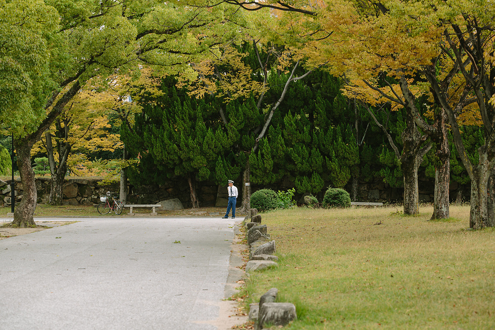 A security guard at Hiroshima Castle, Hiroshima prefecture, Japan.