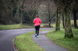 """Embargoed to 2100 Monday October 10 File photo dated 04/01/15 of a person jogging in a park, as attempting to """"blow off steam"""" through vigorous exercise could triple the risk of a heart attack within the hour, experts say."""