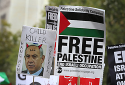 © Licensed to London News Pictures. 09/09/2015. London, UK. Pro-Palestinian protestors carry a placard depicting Israeli Prime Minister Benjamin Netanyahu as they gather outside the gates of Downing Street ahead of his visit tomorrow.  Photo credit: Peter Macdiarmid/LNP