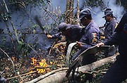 RAINFOREST FIRES DEFORESTATION, Amazon, near Boavista, northern Brazil, South America. Brazilian firemen beating down forest fires. Ecological biosphere and fragile ecosystem where flora and fauna, and native lifestyles are threatened by progress and development. The rainforest is home to many plants and animals who are endangered or facing extinction. This region is home to indigenous primitive and tribal peoples including the Yanomami and Macuxi.