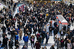 © Licensed to London News Pictures. 26/02/2018. London, UK. Commuters wait at Liverpool Street Station as many train services are delayed or cancelled owing to cold weather. Severe cold, blizzards and heavy snow are expected as the 'Beast from the East' brings freezing Siberian air to the UK. Photo credit: Rob Pinney/LNP