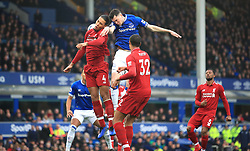 Liverpool's Virgil van Dijk (left) battles for the ball with Everton during the Premier League match at Goodison Park, Liverpool.