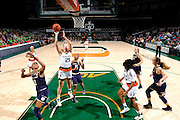 January 8, 2017: Emese Hof #21 of Miami shoots past Lindsay Allen #15 of Notre Dame during the NCAA basketball game between the Miami Hurricanes and the Notre Dame Fighting Irish in Coral Gables, Florida. The 'Irish defeated the 'Canes 67-55.