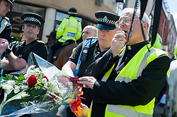 An EDL (English Defence League) organised event to lay flowers at Barkers Pool War Memorial Sheffield,  in memory of Drummer Lee Rigby, resulted in a two hour stand off when Sheffield Unite Against Fascism and One Sheffield Many Cultures supporters occupied Barkers Pool and surrounded the War Memorial leaving police to keep the opposing factions apart. <br /> Father Shaun Smith Chairman of One Sheffield Many Cultures explains to EDL opponents the South Yorkshire Police attempt to negotiate a compromise which would have involved a single police officer laying flowers at the Memorial<br /> 1 June 2013