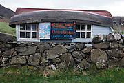 Upturned boat serves as a roof for a teashop and art gallery in Calgary Bay (from whose name the Canadian city takes its name), Calgary Isle of Mull, Scotland.