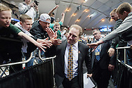 27 MAR 2015: Coach Tom Izzo of Michigan State University high fives fans following his team's win over the University of Oklahoma during the 2015 NCAA Men's Basketball Tournament held at the Carrier Dome in Syracuse, NY. Michigan State defeated Oklahoma 62-58. Brett Wilhelm/NCAA Photos