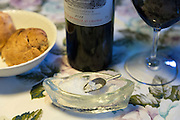 Wine bottle and glass and rock salt at Sonderho Kro Hotel and Restaurant on Fano Island in South Jutland, Denmark