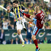 Fenerbahce's Gokhan Gonul and Trabzonspor's Marek Sapara (R) during their Turkish Superleague soccer derby match Fenerbahce between Trabzonspor at the Sukru Saracaoglu stadium in Istanbul Turkey on Monday 24 September 2012. Photo by TURKPIX