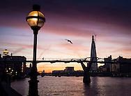 Sunrise over The Shard and Millennium Bridge, London, Britain Jan 2012.