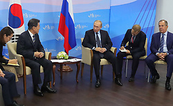 September 6, 2017 - Vladivostok, Primorye Territory, Russia - September 6, 2017. - Russia, Primorye Territory, Vladivostok. - Russian President Vladimir Putin and President of South Korea Moon Jae-in (second left) during a meeting as part of the 3rd Eastern Economic Forum hosted by the Far Eastern Federal University, Russky Island. (Credit Image: © Russian Look via ZUMA Wire)