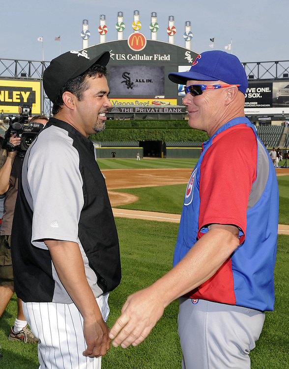 CHICAGO - JUNE 20:  Manager Mike Quade #8 of the Chicago Cubs (R) talks with Manager Ozzie Guillen #13 (L) of the Chicago White Sox prior to the game on June 20, 2011 at U.S. Cellular Field in Chicago, Illinois.  The Cubs defeated the White Sox 6-3.  (Photo by Ron Vesely)  Subject:  Mike Quade;Ozzie Guillen