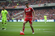 Middlesbrough defender Daniel Ayala (4)  popping a balloon during the Sky Bet Championship match between Middlesbrough and Brighton and Hove Albion at the Riverside Stadium, Middlesbrough, England on 7 May 2016. Photo by Simon Davies.