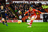 Cameron McGeehan of Barnsley (8) hits a shot from outside the box during the EFL Sky Bet League 1 match between Barnsley and Bradford City at Oakwell, Barnsley, England on 12 January 2019.