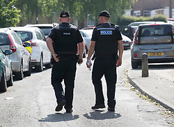 © Licensed to London News Pictures. 26/05/2018. Crawley, UK. Police officers are seen outside a block of flats in Crawley where a woman was found dead.  A man has been arrested on suspicion of murder after the woman was found in her bed. Police are appealing for witnesses to come forward.  Photo credit: Peter Macdiarmid/LNP