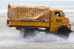 The official TROG (The Race Of Gentlemen) truck races through the rising tide. Wildwood, NJ. USA. Saturday June 9, 2018. Photography ©2018 Michael Lichter.