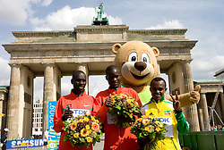 Second placed Emmanuel Kipchirchir Mutai of Kenya, Winner Albel Kirui of Kenya and third placed Tsegay Kebede of Ethiopia at the flower ceremony after  the men's 42km Marathon Race during the 2009 IAAF Athletics World Championships on August 22, 2009 in Berlin, Germany. (Photo by Vid Ponikvar / Sportida)