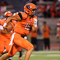 Joshua James carries the ball for the Gallup Bengals in their game against the Grants Pirates at Angelo Dipaolo Memorial Stadium in Gallup, Friday, August 31, 2018.