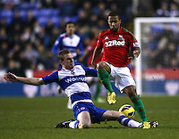 Reading's Alex Pearce and Swansea City's Wayne Routledge in action during todays match  ..Football - Barclays Premiership - Reading v Swansea City - Wednesday 26th December 2012 - Madejski Stadium - Reading..