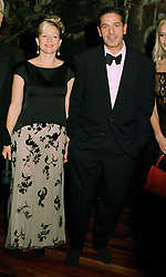 MR & MRS CHARLES SAATCHI he is the advertising supremo, at a dinner in London on 1st July 1997.LZW 20 2ICO