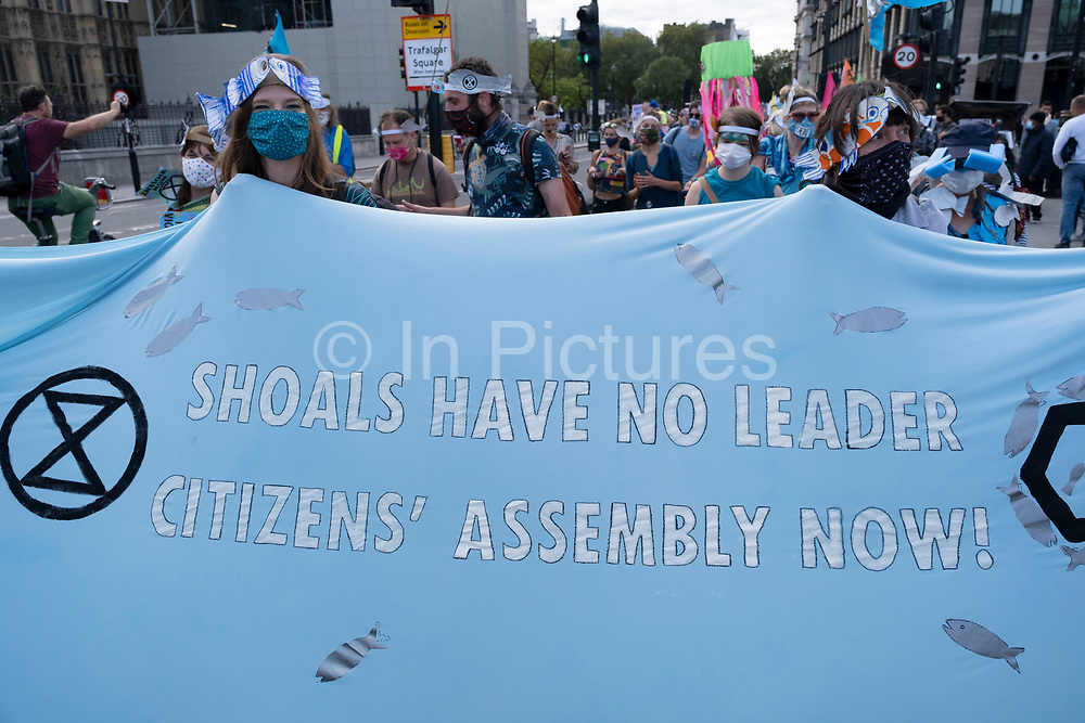 Extinction Rebellion activists at the Marine Rebellion march on 6th September 2020 in London, United Kingdom. Ocean Rebellion, Sea Life Extinction, Animal Rebellion and Extinction Rebellion joined together to celebrate the biodiversity found in our seas, and to grieve at the destruction of the Earth's oceans and marine life due to climate breakdown and human interference, and the loss of lives, homes and livelihoods from rising sea levels. Extinction Rebellion is a climate change group started in 2018 and has gained a huge following of people committed to peaceful protests. These protests are highlighting that the government is not doing enough to avoid catastrophic climate change and to demand the government take radical action to save the planet.