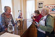 Customers Sue Heise (2nd R) and Klaras Ihnken (R) speak with proprietors Deborah Fay Morales (2nd L) and Susan Williams (L) at Gallery 360 which has opened  in its new space at the Slocum House in downtown Vancouver Saturday November 1, 2014.. (Natalie Behring/for the Columbian)
