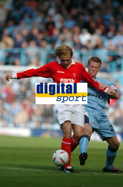 Photo. Leigh Quinnell.  Coventry City v Rotherham United Coca Cola championship. 18/09/2004.<br /> coventrys Matthew Mills challenges Richard Barker