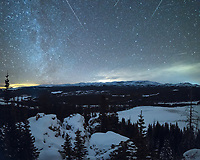 In early January is the annual Quadrantid meteor shower. Meteor rates weren't nearly as prolific as the Geminids of December. But I still wanted to photograph it since the moon phase was favorable and few pictures of this astronomical event exist. With decent weather in the forecast, I climbed to the top of a 9,477' mountain and spent the night there. The expansive views to the north included Meadowlark Lake, the tallest peaks of the Bighorns, and the High Park meadow. After chasing a mouse out of my backpack I set my camera to take pictures for most of the night. The shower seemed to be most active between about 10PM and midnight. That's when my camera captured these 8 meteors, although 3 of them were halfway out of the frame. I stitched together a few images for the bottom half of the picture, this allowed me to correct the distortion in the trees.