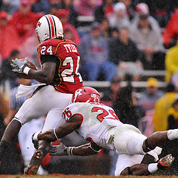 Sep 26, 2009; College Park, MD, USA; Rutgers cornerback Joe Lefeged (26) tackles Maryland wide receiver Ronnie Tyler (24) during the first half of Rutgers' 34-13 victory over Maryland in NCAA college football at Byrd Stadium.