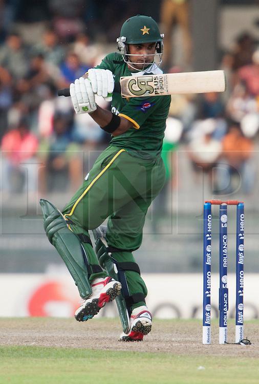 © Licensed to London News Pictures. 28/09/2012. Pakistani batsmen Imran Nazir batting during the T20 Cricket World cup match between South Africa Vs Pakistan at the R.Premadasa Cricket Stadium,Colombo. Photo credit : Asanka Brendon Ratnayake/LNP