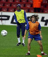 Photo: Paul Thomas.<br />Barcelona Press Conference. UEFA Champions League. 05/03/2007.<br /><br />Samuel Eto'o (Yellow) of Barcelona watches Carlos Puyol.