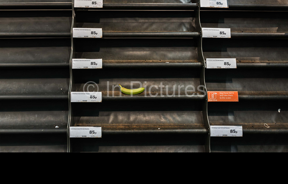 The last banana left on the empty shelves for fruit in a Tesco supermarket on 18th May 2020 in London, United Kingdom. Supermarkets have been working around the clock to keep up with growing customer demands amid the coronavirus crisis. With many Britons rushing to stores to stockpile essential items, supermarkets across the nation have been forced to impose strict rules.