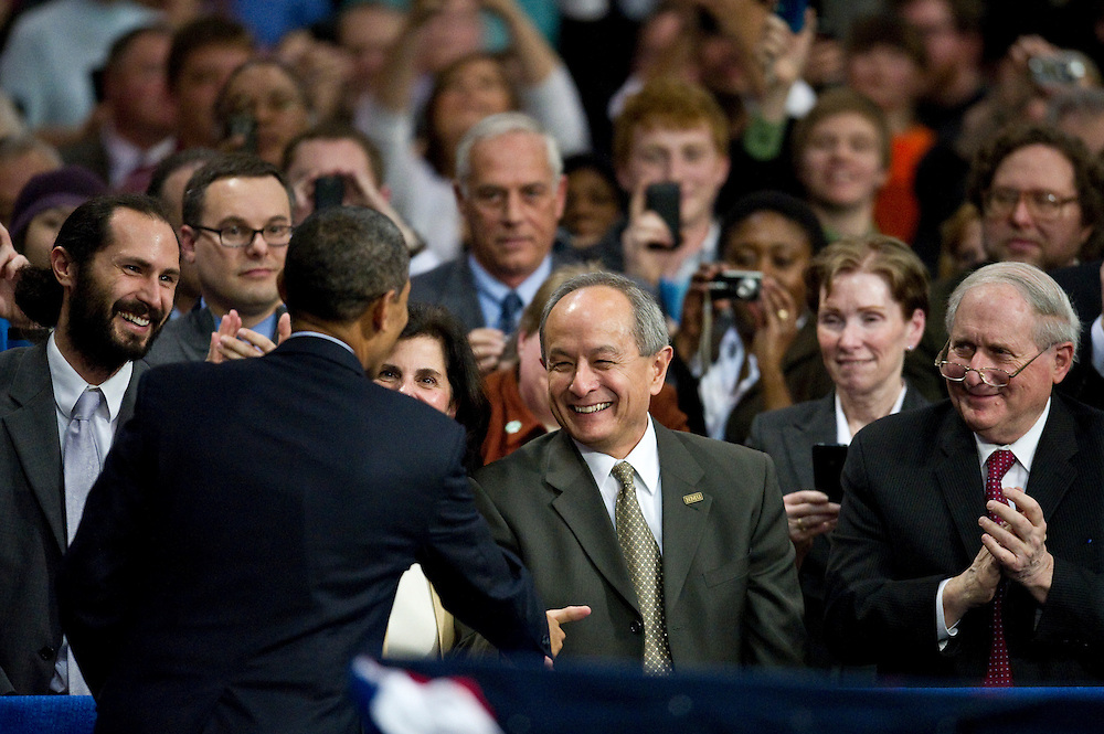 President Obama greets NMU president Les Wong during his visit to Northern Michigan University February 2011.