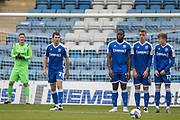 John Akinde, Forward with Gillingham (15), Jack Tucker, Defender with Gillingham (5) & Josh Eccles, Defender with Gillingham (17) in the wall with Thomas Edwards, Defender with Fleetwood Town FC (2) taking the free kick during the EFL Sky Bet League 1 match between Gillingham and Fleetwood Town at the MEMS Priestfield Stadium, Gillingham, England on 24 October 2020.